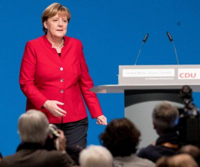 In a shift to the right, Germany's Merkel calls for burqa ban