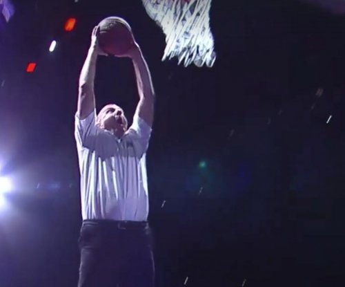 Los Angeles Clippers owner Steve Ballmer dunks at halftime
