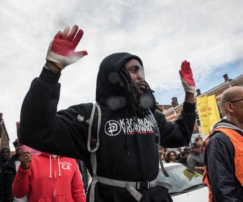 Flashes of violence stain peaceful Baltimore protests over Freddie Gray death