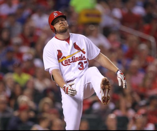 Brandon Moss hits 2 of St. Louis Cardinals' 4 homers in rout of Cincinnati Reds