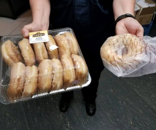 Man makes good on Facebook bet with police, turns self in with doughnuts