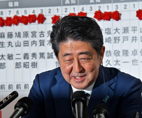 Japan election: Abe's coalition projected to keep supermajority