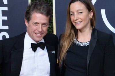 Hugh Grant marries Anna Eberstein in London
