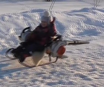 Dad creates snowmobile from a sled and two leaf blowers