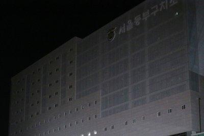Former South Korean president refuses questioning under detention