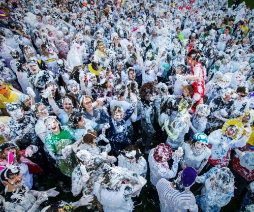 Hundreds of students fling shaving cream in annual foam fight