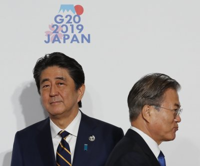 South Korea president pledges 'different path' in Japan trade row