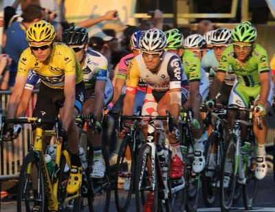 Froome finishes third Saturday to virtually ice Tour de France