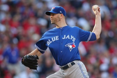 J.A. Happ pitches into seventh as Toronto Blue Jays beat Chicago White Sox