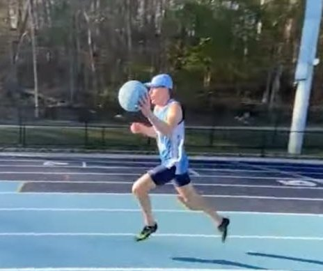 Man breaks 1-mile basketball dribbling world record by 0.02 seconds