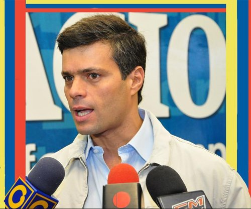 Venezuelan opposition leader Leopoldo Lopez sentenced to nearly 14 years