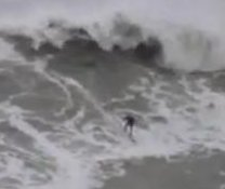 Australian surfers take on massive storm waves in Portugal