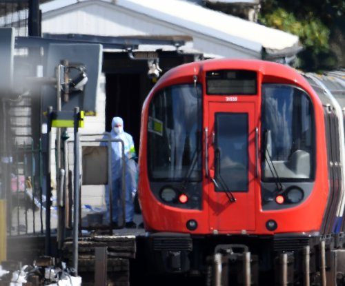 Met police arrest third suspect in London tube attack