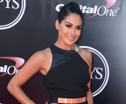 Brie Bella shares photo of daughter Birdie playing with Bella doll
