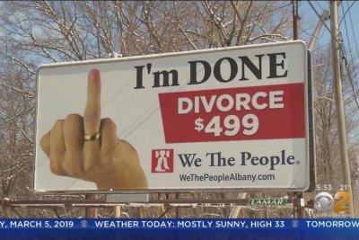 Divorce services billboard's raised finger raises controversy