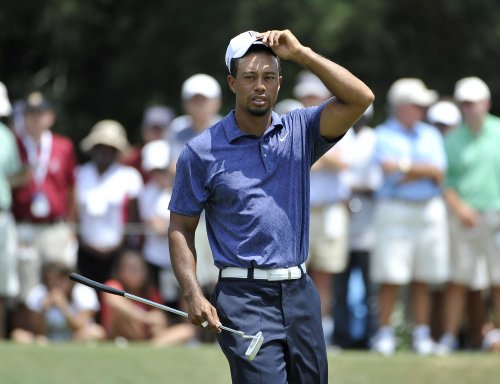 Report: Woods, Romo to pair up in pro-am