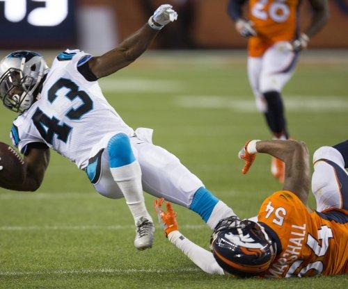 Denver Broncos' Brandon Marshall kneels for anthem