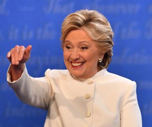 President in a pantsuit? How Hillary Clinton turned signature look into symbol of empowerment