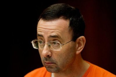 Ex-USA Gymnastics doctor Larry Nassar pleads guilty to child porn charges