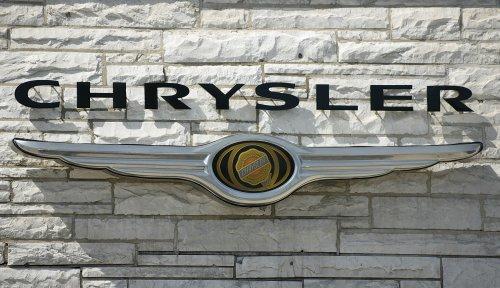 Chrysler wins over a key executive