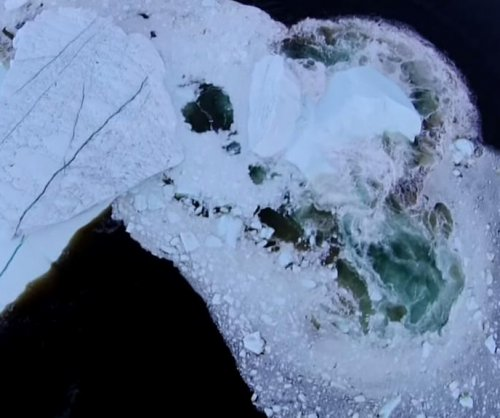 Drone records 'rare' iceberg collapse in Newfoundland