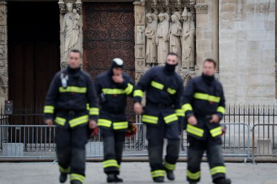 France honors firefighters who battled Notre Dame fire