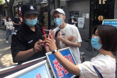 Beijing district shuts down market after new coronavirus outbreak