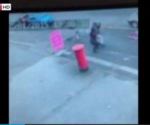 CCTV: Manhole explosion narrowly misses toddler