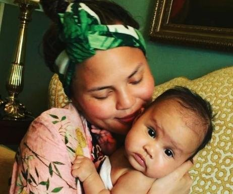 Chrissy Teigen cradles daughter Luna prior to Beyonce show