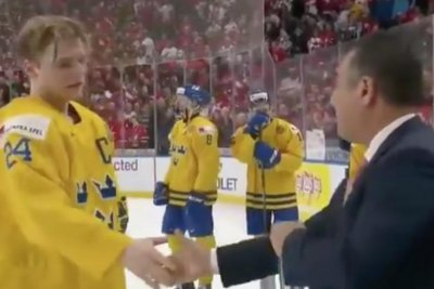 Swedish hockey team captain throws silver medal into crowd