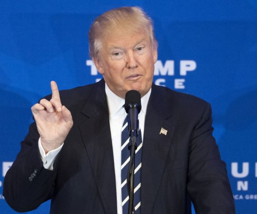Donald Trump rushed off stage under weapons threat; no gun found
