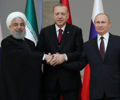 Putin, Rouhani, Erdogan meet to discuss fighting in Syria