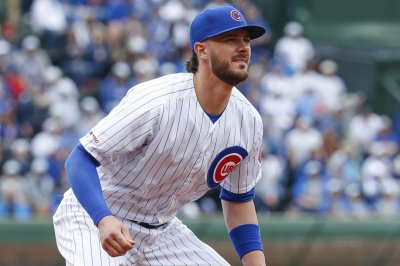 Cubs' Kris Bryant turns rare triple play in loss to Reds