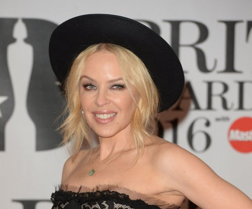 Kylie Minogue shows off engagement ring at Brit Awards