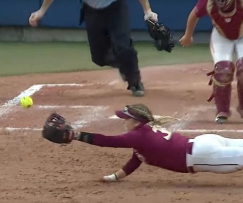 Florida State softball player makes full-extension double play