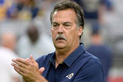 Ex-coach Fisher reportedly in talks with FOX