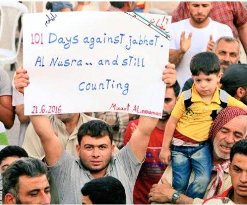 Rural Syrian town's long-running protests target multiple enemies