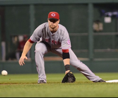 Zack Cozart, Jay Bruce power Cincinnati Reds past Chicago Cubs