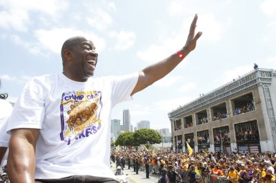 Magic Johnson named to top Lakers post; GM Kupchak fired
