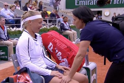French Open: Women's favorite Bertens tearfully withdraws, Federer dominates