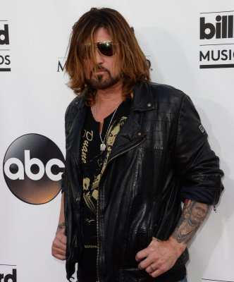 Billy Ray Cyrus honors slain Nevada teacher during concert