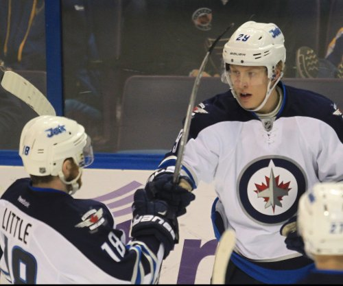 Bryan Little lifts Winnipeg Jets past St. Louis Blues in OT