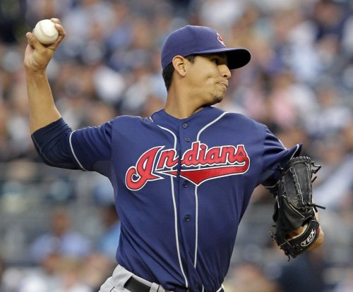Carlos Carrasco pitches Cleveland Indians to 2-0 start after downing Texas Rangers