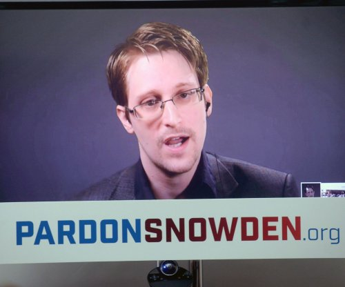 Hong Kong rejects asylum claims of group that hid Snowden