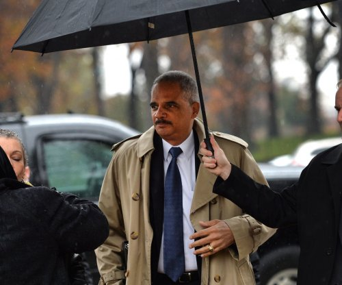 Eric Holder booed by protesters while speaking to Atlanta church about Ferguson