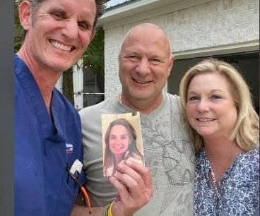Watch: Man reunited with hurricane-blown photo of late wife