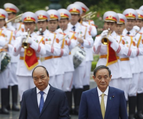 Japan warns against illegal maneuvers in South China Sea