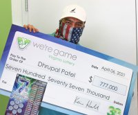 Family's scenic route home from vacation leads to $777,777 lottery prize