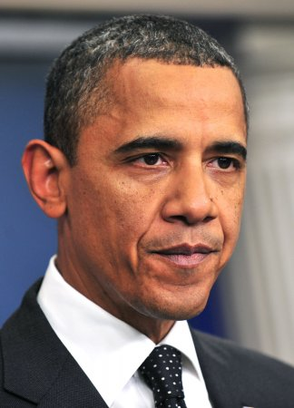 Obama presses payroll tax holiday