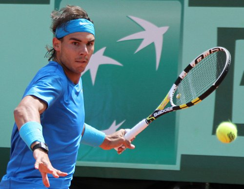 Nadal battles to second-round win in Paris